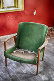 Abandoned green chair Stock Images