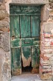 Abandoned green door with stone wall royalty free stock image