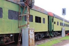 Abandoned green train boxcars alongside train light posts. Horizontal aspect Stock Photography
