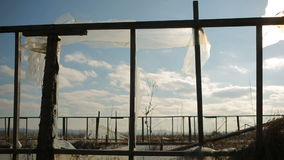 Abandoned greenhouse on the background of blue sky and white clouds. stock footage