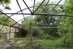 Abandoned greenhouse in Broken Arrow, Oklahoma 1. An overgrown, dilapidated greenhouse in Tulsa county, Oklahoma, picture  1 Stock Image