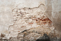 Abandoned grunge cracked brick stucco wall Stock Photos