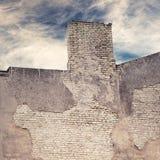 Abandoned grunge cracked brick stucco wall Stock Images