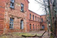 Abandoned Gurievskaya agricultural school, Russia. Abandoned Gurievskaya agricultural school. The building of the late 19th century. Village of Solovjinye Zori royalty free stock image