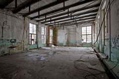 Abandoned hall. Grunge abandoned hall of an old factory Stock Images