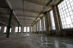 Abandoned hall. Grunge abandoned hall of an old factory, perspective view Royalty Free Stock Image
