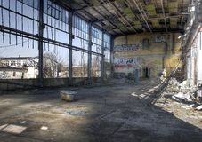 Abandoned hall with a tub Stock Images