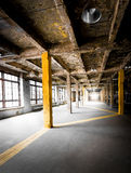 Abandoned hallway with big windows at factory Stock Photo