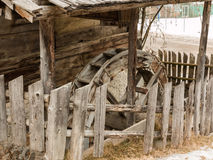 Abandoned historic old wooden water mill house. Waterwheel Royalty Free Stock Image