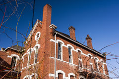 Abandoned, Historic School with Red Brick and White Limestone Lintels Stock Photo