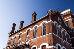 Abandoned, Historic School with Red Brick and White Limestone Lintels Royalty Free Stock Photo
