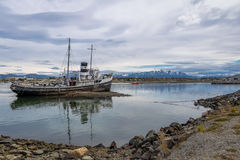 Abandoned HMS Justice tug boat grounded in Patagonia - Ushuaia, Tierra del Fuego, Argentina. Abandoned HMS Justice tug boat grounded in Patagonia in Ushuaia Stock Photography