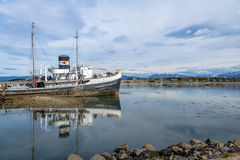 Abandoned HMS Justice tug boat grounded in Patagonia - Ushuaia, Tierra del Fuego, Argentina. Abandoned HMS Justice tug boat grounded in Patagonia in Ushuaia Royalty Free Stock Photography