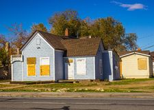 Abandoned Home With Boarded Up Doors & Windows Royalty Free Stock Image