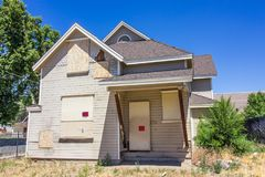 Abandoned Home With Boarded Up Windows & Doors. Abandoned Two Story Home With Boarded Up Windows & Doors stock photos