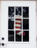 Abandoned Home with Christmas Stocking in Door Window Royalty Free Stock Photos