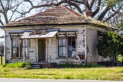 Abandoned Home In Disrepair. With Peeling Paint & Open Door Stock Image