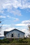 Foreclosed Real Estate. Abandoned home under blue skies Royalty Free Stock Photo