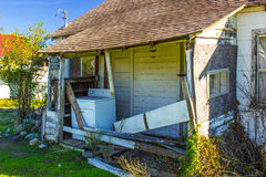 Abandoned Home With Washer On Porch Royalty Free Stock Photo