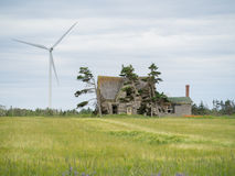 Abandoned home and windmill Royalty Free Stock Photos