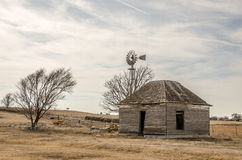 Abandoned Home and Windmill Royalty Free Stock Photo