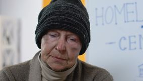 Abandoned homeless female looking to camera in despair, social support center stock video