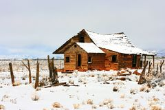 Abandoned homestead on prairie in winter snows Stock Image