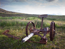 Abandoned horse pulled grass cutter in Iceland royalty free stock photo
