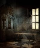 Abandoned hospital room. Abandoned room with a hospital table Royalty Free Stock Photos