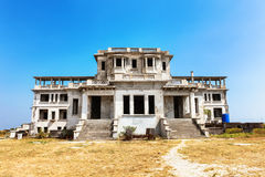 Abandoned hotel Bokor Palace in Ghost town Hill station near Kampot. Cambodia Royalty Free Stock Photos