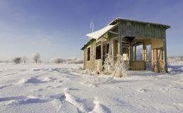 Abandoned house. On a winter field scenery Stock Photos