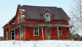 Abandoned House. An old abandoned house on a winter day stock image