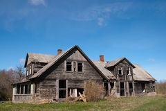 Abandoned house. Old wooden abandoned house with broken windows Royalty Free Stock Images