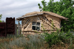 An abandoned house. Old abandoned house in the middle of thick vegetation Stock Image