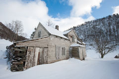 Abandoned house. Old worn abandoned house in norwegian winter landscape Stock Photography