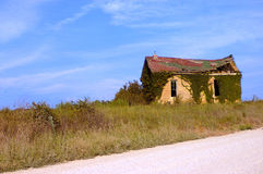Abandoned House. An abandoned and derelict country house on the side of the road stock images