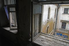 Abandoned house. View through window in View through window in abandoned house to backyard to backyard stock photo