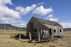 Abandoned house. An old, abandoned house in a field Royalty Free Stock Photo