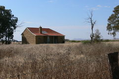 Abandoned house. In field stock photo
