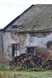 Abandoned house. Abandoned and deteriorated house on a field near a road stock photo