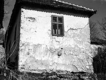 Abandoned house in abandoned Serbian mountain village. Abandoned house in abandoned Serbian village. Serbian mountain village. South Serbia. Black and white stock photo