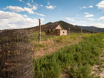 Abandoned House and Barb Wire in Summer Stock Photography