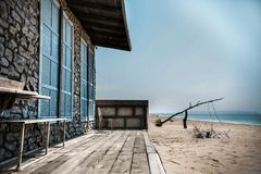 Abandoned house on the beach stock photo