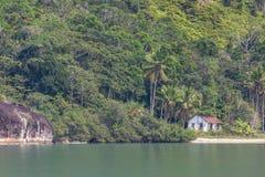 Abandoned house in beach of Saco do Mamangua stock image