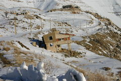 Abandoned House. Broken down and abandoned house amidst the snowy mountain range Stock Photography