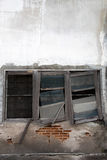 Abandoned house with broken window and wall. Abandoned old house with broken window and brick wall Royalty Free Stock Photos