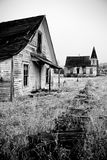 Abandoned house and church royalty free stock photo