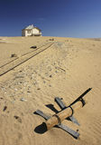 Abandoned house in desert. Showing ruined railway line and sign post Royalty Free Stock Images