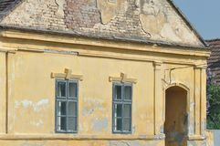 Abandoned house detail. Abandoned and deteriorated brick house detail royalty free stock photo