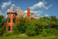 Abandoned house in Detroit. An abandoned house in the city of Detroit is taken over by plants and trees stock images